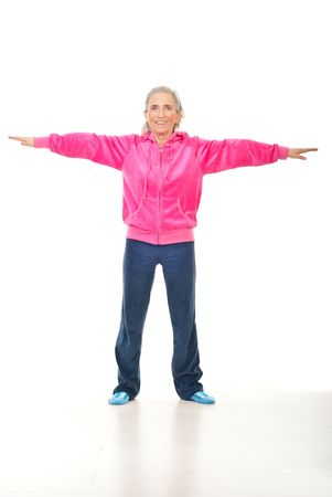 Active smiling senior woman doing sport over white background photo