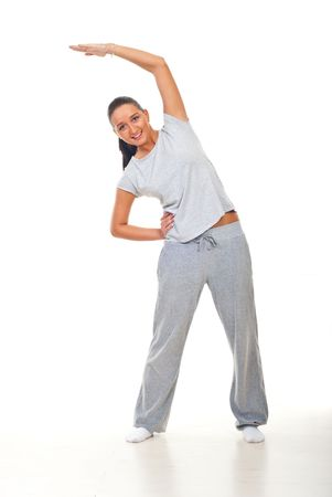 Young woman doing fitness  over white background photo