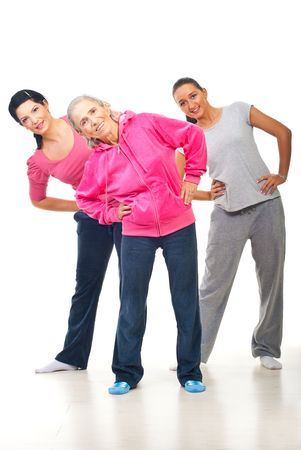 Three women young and senior doing sport over white background photo