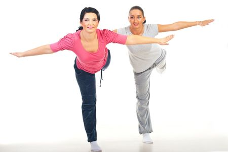 Two women standing with hands  outstretched and making exercises Stock Photo - 8156387
