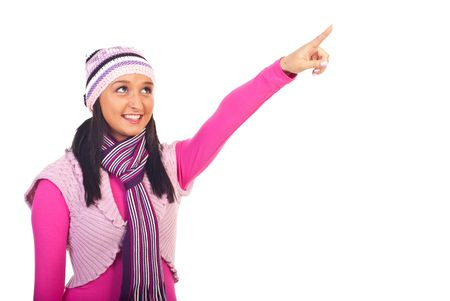Beauty young woman in pink winter clothes pointing up to copy space isolated on white background Stock Photo - 8156392