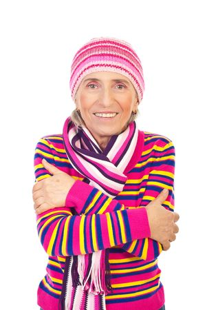 Beautiful smiling senior woman dressed in pink knitted clothes standing with hands crossed isolated on white background Stock Photo - 8156406