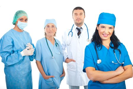 Smiling surgeon woman and her team isolated on white background photo