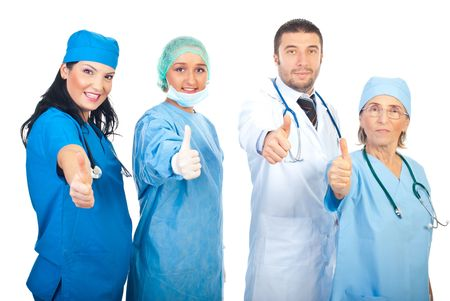 Different doctors team standing in a row and giving thumbs up isolated on white background photo