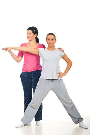 Personal trainer assist and help woman at fitness over white background photo