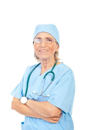 Portrait of smiling senior woman doctor wearing eyeglasses and standing with arms folded isolated on white background photo