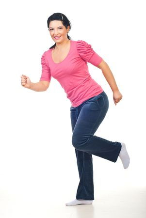 Happy woman  training for run in studio isolated on white background photo