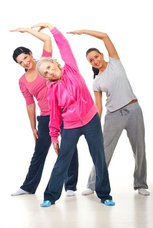Healthy three women workout and stretching hands  over white background photo