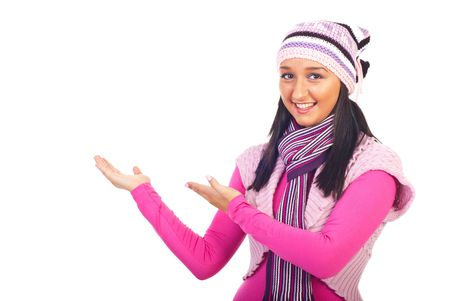 Smiling youg woman in woolen clothes making presentation  to copy space isolated on whie background Stock Photo - 8156449