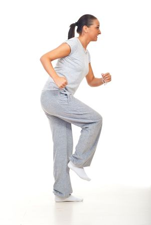 Young woman training and working her legs over white background photo