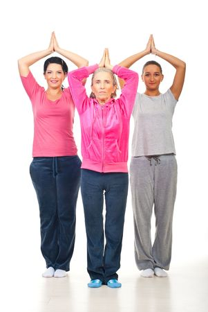 Group of three woman doing yoga over white background Stock Photo - 8156476