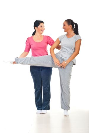 sportwoman: Woman and her personal trainer laughing together at gym Stock Photo