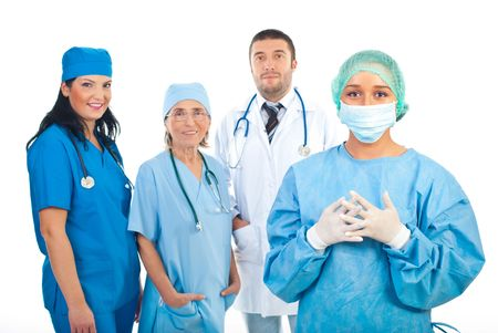 Smiling surgeon woman in front of image  and  team of hospital doctors in background Stock Photo - 8156478
