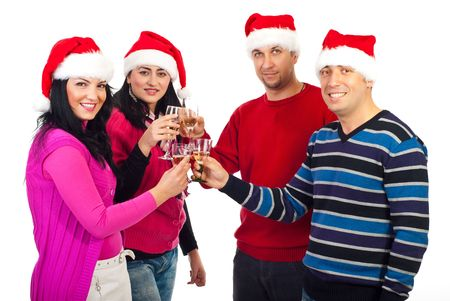 Two cheerful couple in Santa hats toasting with champagne and celebrate Christmas isolated on white background photo
