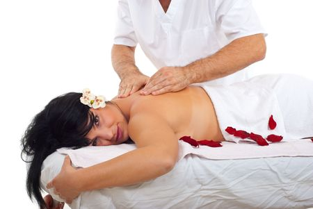 Beautiful woman getting massage at spa resort by a male masseur photo