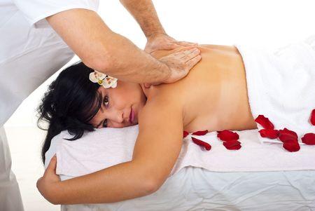 Beauty woman getting back spa massage by a professional masseur man photo