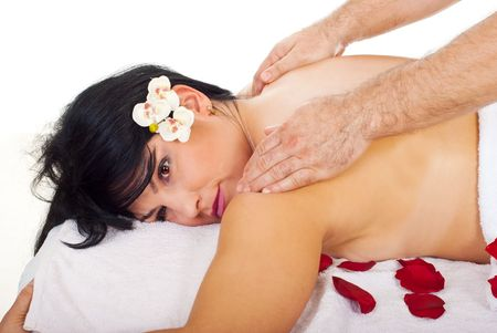 Close up of a pretty woman getting back massage by a professional masseur man in a spa resort photo