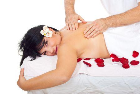 Real professional masseur massaging smiling woman back at spa resort photo
