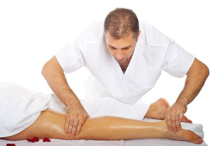 oiled: Real proffesional masseur massaging womans leg with oil