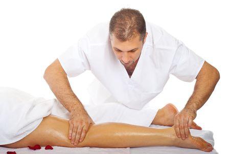 masseur: Real proffesional masseur massaging womans leg with oil