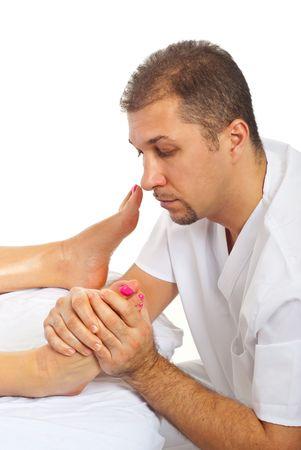 Othopaedist man with beard massaging woman leg  photo
