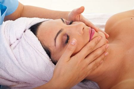 Close up of woman getting facial massage at spa retreat photo
