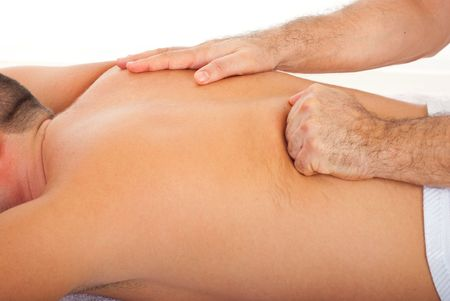 masseur: Close up of man getting deep back massage from a professional masseur Stock Photo