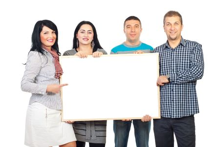 placard: Happy group of four people holding a blank banner and one woman pointing to copy space isolated on white background Stock Photo