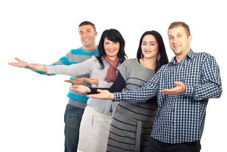 welcome smile: Group of four people making presentation or welcoming and all of them standing with palms open to copy space isolated on white background