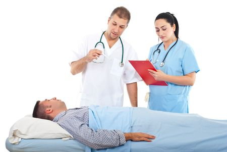 Doctor checking temperature to a sick patient in bed and  nurse writing in clipboard  in a hospital photo
