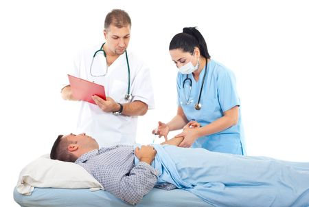 Doctor woman or nurse with mask vaccine sick patient male in bed and other doctor writing in clipboard photo
