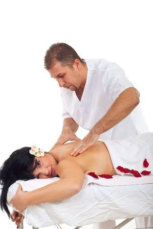 Masseur man giving a  shiatsu back massage for relaxing to a brunette woman  at spa resort photo