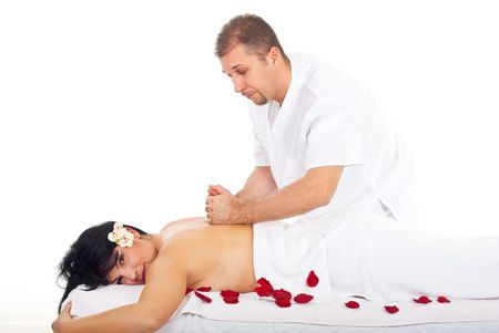 Real masseur giving kneading massage style  on a back woman at spa  photo