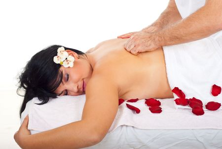 Masseur use friction massage type on  back woman  at spa resort photo