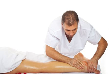 oiled: Real professional masseur giving therapeutic massage to womans legs Stock Photo