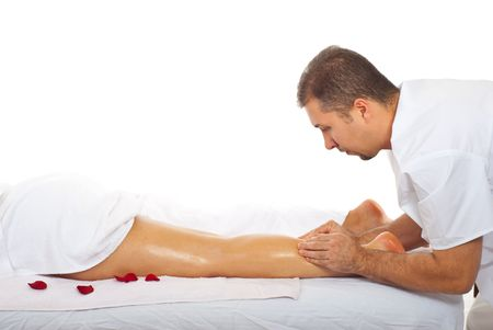 oiled: Woman receiving kneated massage type on her leg from a professional masseur Stock Photo
