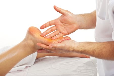 Masseur  give reflexology massage on womans foot photo