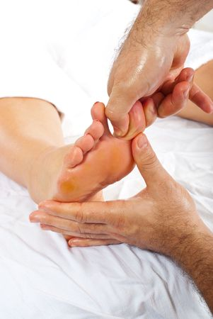 Masseur make reflexology massage to woman foot  pressure toe photo