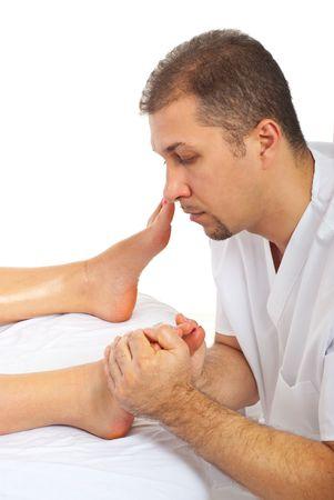 massaging: Therapist man massaging  woman foot at spa salon Stock Photo