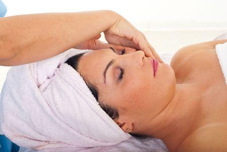 Cute woman receiving facial massage at spa salon Stock Photo - 8203288