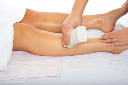 Beautician waxing womans leg at spa salon Stock Photo