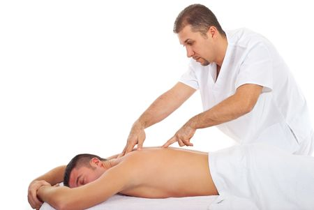 shiatsu: Man receiving Shiatsu massage from a professional masseur at spa salon