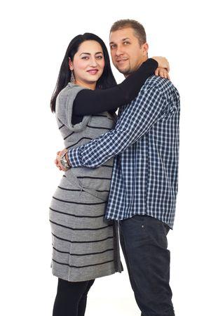 mid adult couple: Bonita mediados permanente de adultos de pareja en el abrazo y el marido celebraci�n de manos alrededor de su islated sobre fondo blanco  Foto de archivo