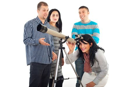 Laughing woman watching stars through telescope while her friends talking and smile together isolated on white background photo