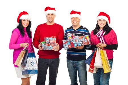 Happy Christmas people friends standing in a row and holding shopping bags and presents isolated on white background photo