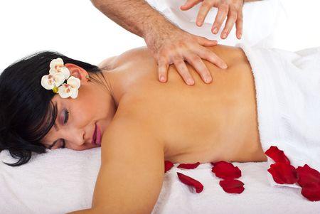 Close up of beautiful woman with  eyes closed enjoying a back spa massage  photo