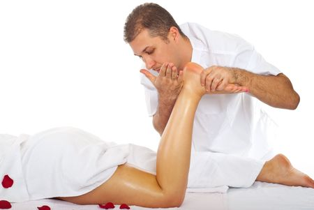 Masseur giving anti cellulite massage to a woman legs in a spa salon photo