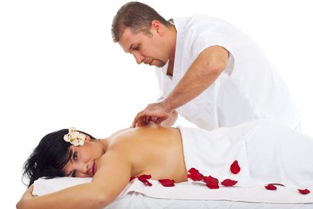 Masseur man apply kneaded  skin massage on woman back at spa resort photo