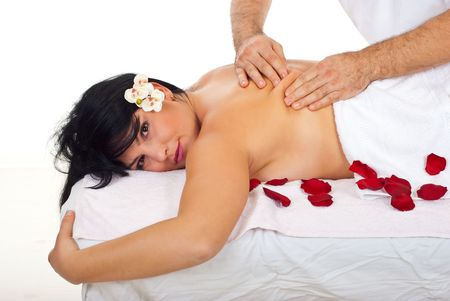 Close up of woman at spa massage getting kneading back skin massage from a professional masseur photo