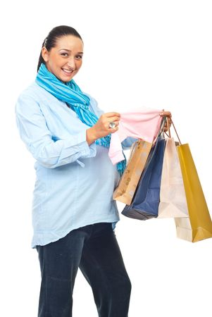 Excited pregnant woman at shopping just bough baby pink cloth and  smiling at camera isolated on white background photo